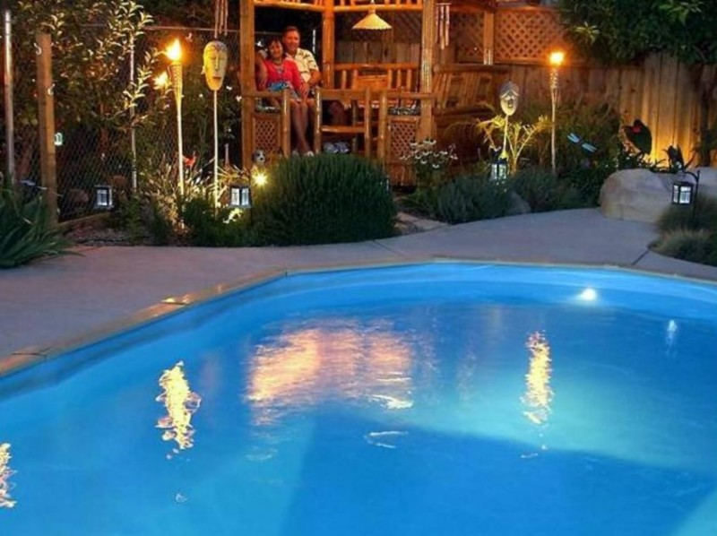 40 uniquely awesome above ground pools with decks for Above ground pool lighting ideas