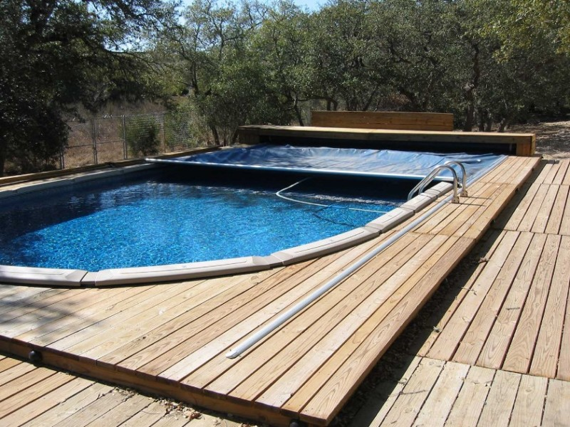 40 uniquely awesome above ground pools with decks for Above ground pool cover ideas