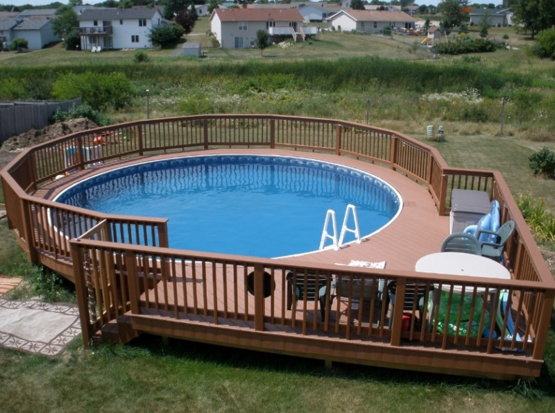 40 uniquely awesome above ground pools with decks for Round swimming pools above ground