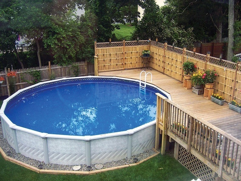 Above ground swimming pools with decks and fences home for Top of the line above ground pools
