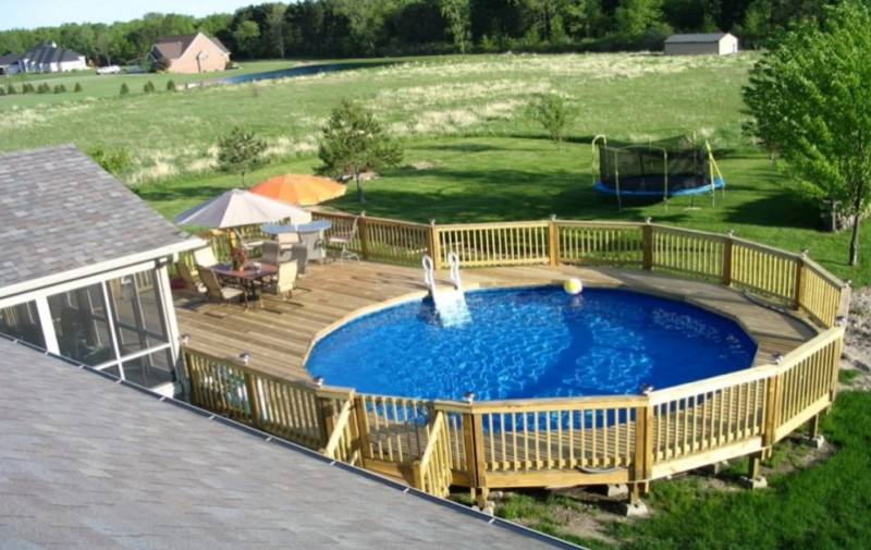 Above ground pool designs with wood railing and table sets