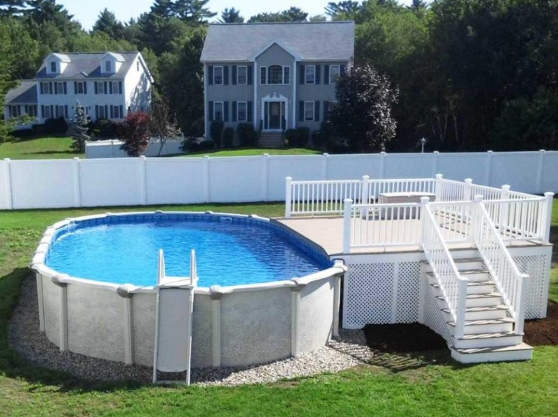 above ground pool deck ideas with pebble stone around pool also vinyl lattice deck skirting in white - Above Ground Pool Outside Steps