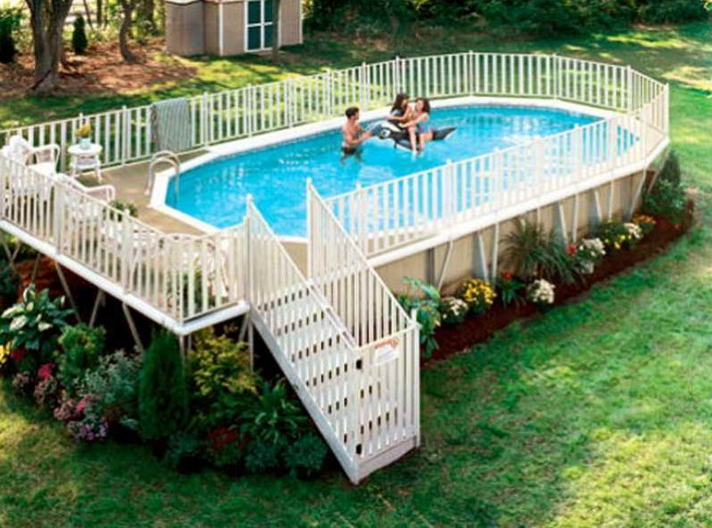 beautiful fenced in deck above ground pool