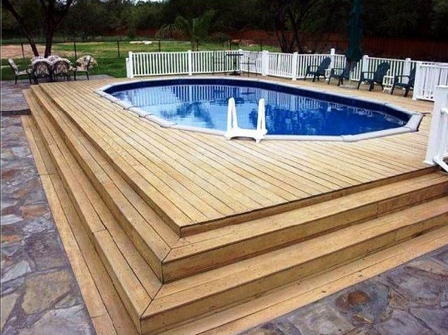 Above ground pool with a wood deck in San Antonio, Texas.