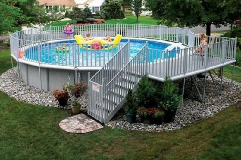 A Round Above Ground Swimming Pools With Decks