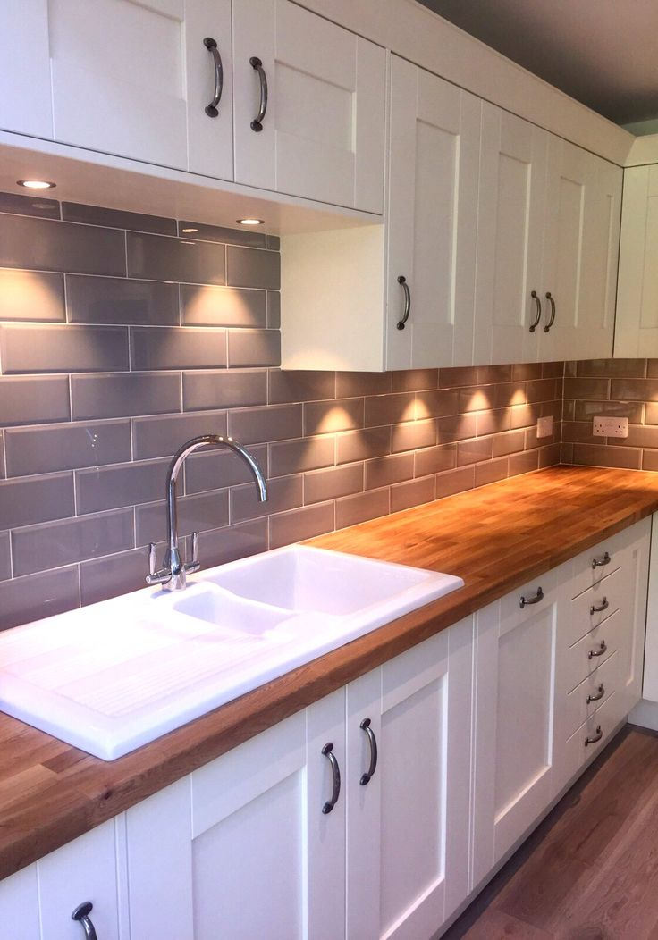 Edge Grigio tiles look lovely in a cream kitchen with wooden worktops
