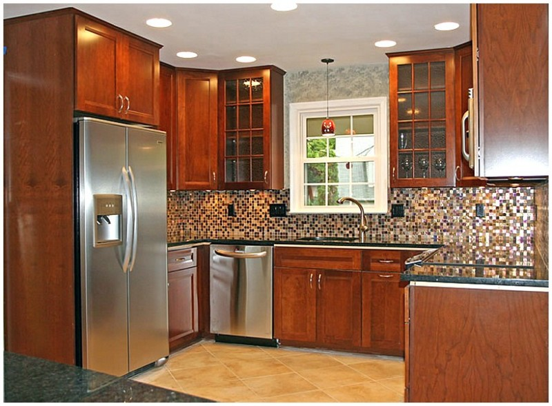 Small Kitchen Decorating Ideas With Ceramic Floor and Brown Cabinet Also Refrigerator