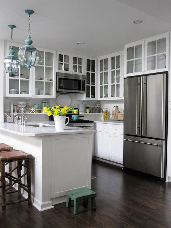 Small Kitchen Ideas - Replace solid cabinet doors with glass ones