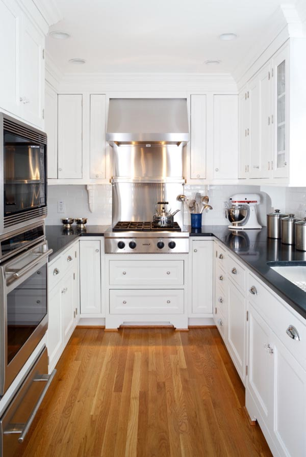 Small Kitchen Ideas - Using a galley kitchen design, the cabinets and appliances line up on either side of a corridor