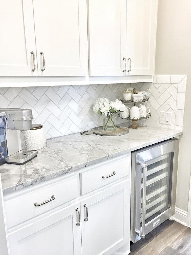 Small butler's pantry with herringbone backsplash tile