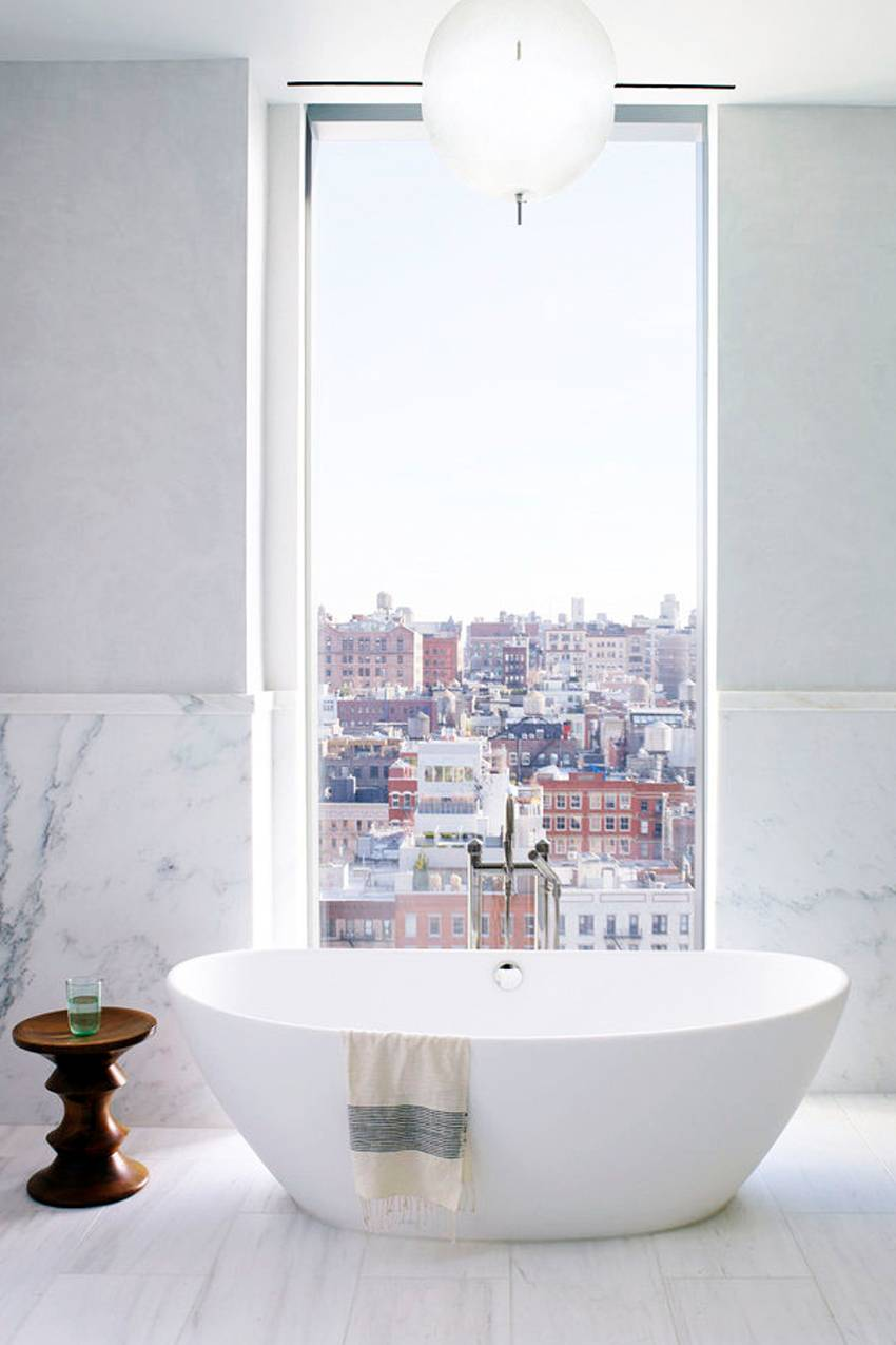 A cityscape is a welcome view from the bathtub