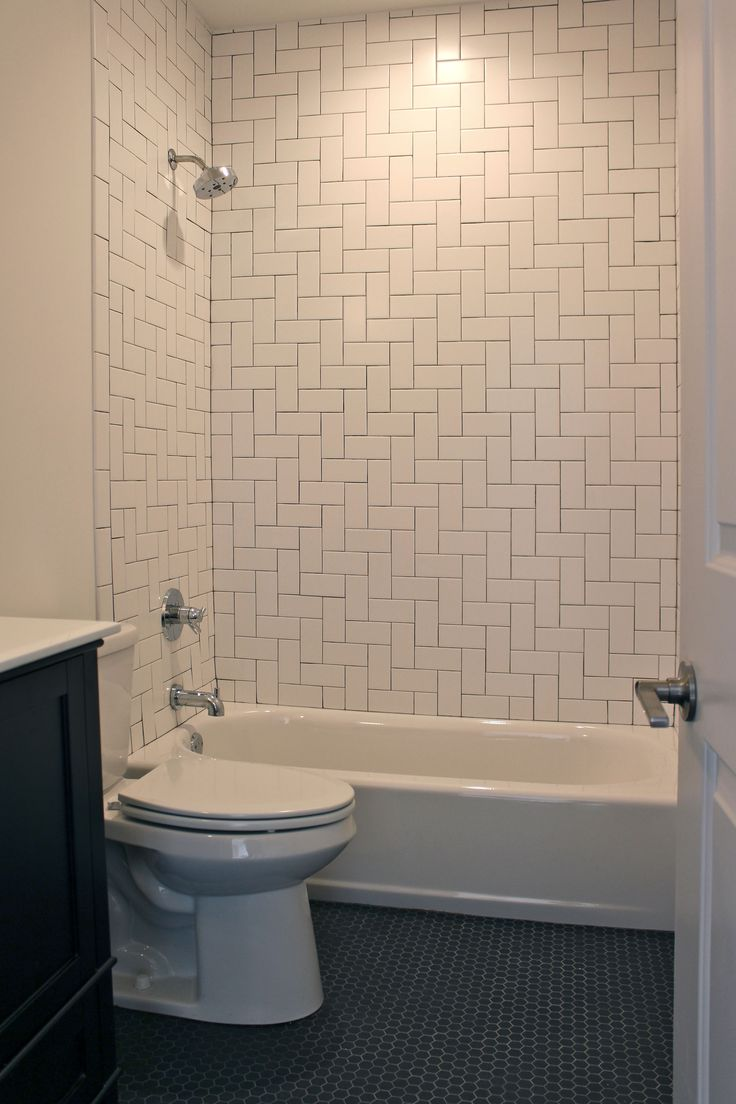 Bathroom with herringbone pattern white subway tile