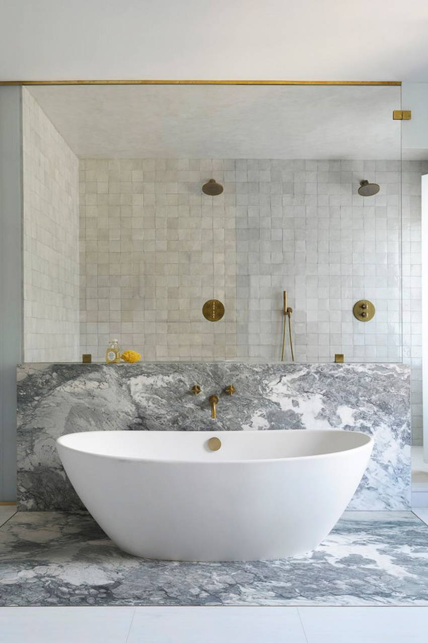The pared-down design choices in this bathroom are absolutely stunning