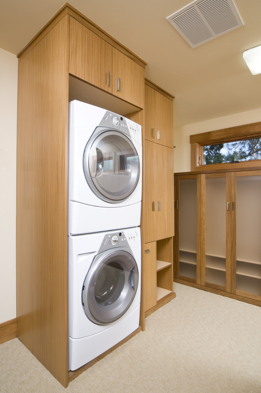 Custom built cabinet for stackable washer and dryer