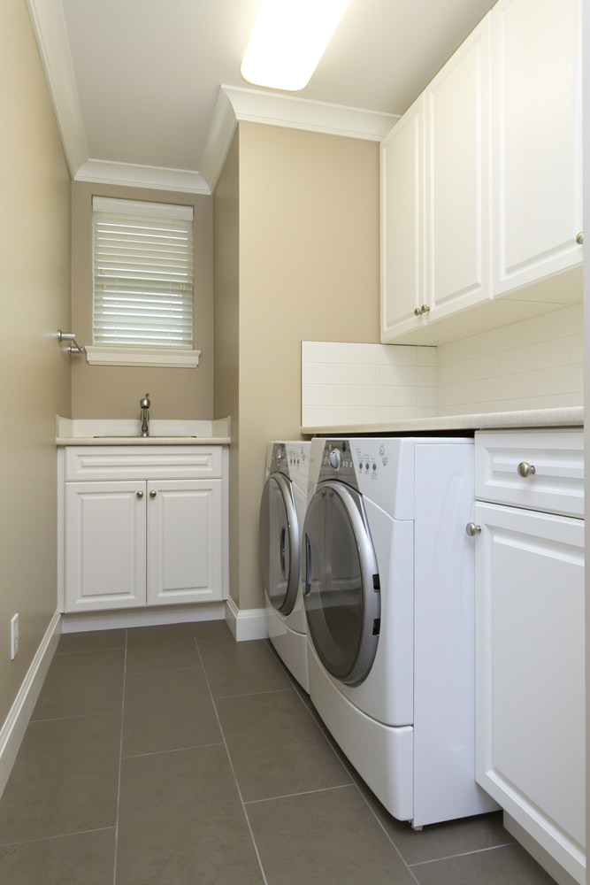 Small laundry room with nook sink and cabinet