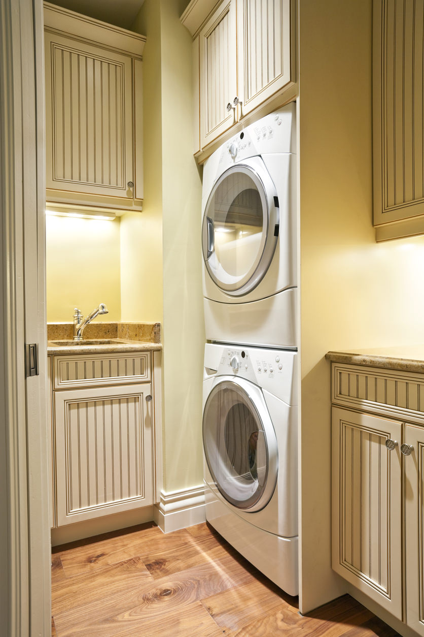 Tiny laundry room with stacked washer